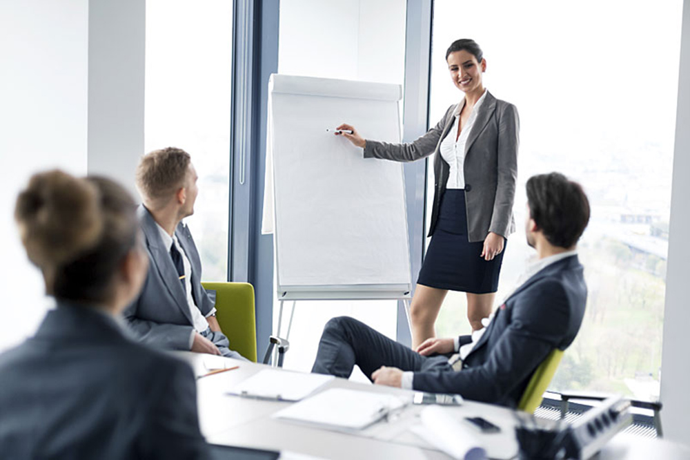 Businesswoman holding presentation in board room, copy space